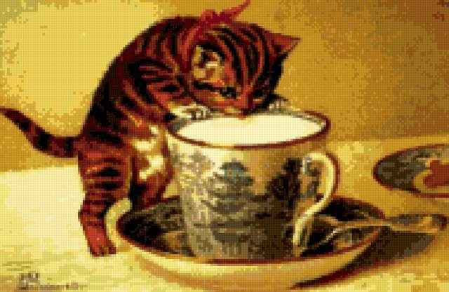 Котёнок и чашка чая,