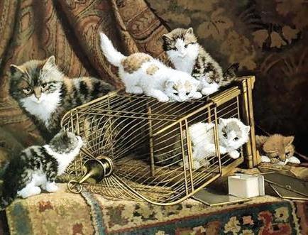 Котята у птичьей клетки,